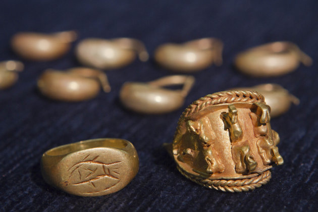 In this photo taken Wednesday, May 23, 2012, ancient jewelry discovered by Israeli archaeologists is displayed at  the Tel Aviv University, Israel. Israeli archaeologists have unearthed a stash of rar