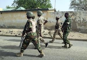 A photo released by the Nigerian Army shows soldiers …