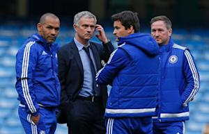 Chelsea manager Jose Mourinho (2nd left) stands with…