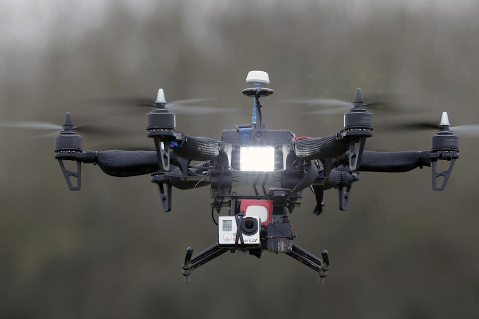 """FILE - In this Monday Feb. 9, 2015 file photo, French company Malou Tech's  """"Army"""" speed drone mounted with a Go pro Hero3 performs..."""