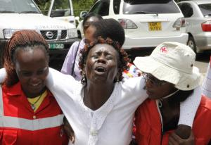 Red Cross staff console a woman after she viewed the …