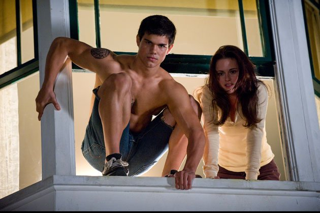 Twilight Sexiest Moments: Taylor Lautner gets his muscles out as Jacob makes his way out of Bella's window.