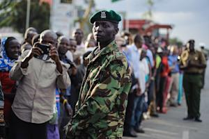 Kenyans line up to see the Pope's convoy arrive …