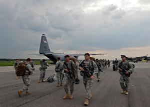 The first American troops arrive at the airport in…