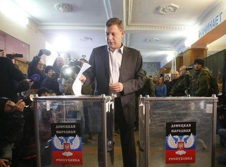 Alexander Zakharchenko, separatist leader of the Donetsk People's Republic, casts a ballot during its leadership and local parliamentary elections...