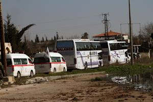 Some Syrian people on two buses followed by the Syrian …