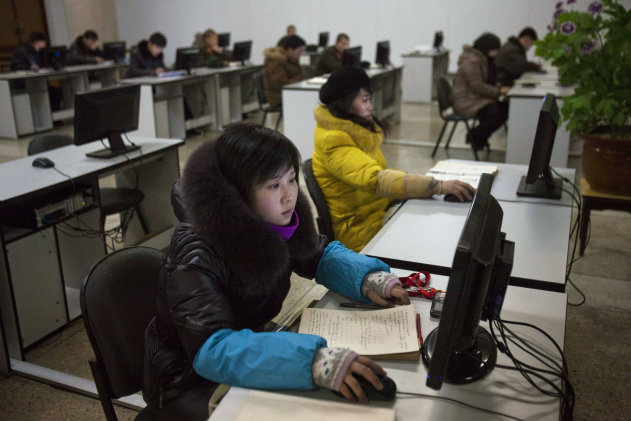"FILE - In this Jan. 9, 2013 file photo, North Koreans work at computer terminals inside the Grand People's Study House in Pyongyang, North Korea. Investigators have yet to pinpoint the culprit behind a synchronized cyberattack in South Korea last week. But in Seoul, the focus remains fixed on North Korea, where South Korean security experts say Pyongyang has been training a team of computer-savvy ""cyber warriors"" as cyberspace becomes fertile battlegrounds in the standoff between the two Koreas. (AP Photo/David Guttenfelder, File)"