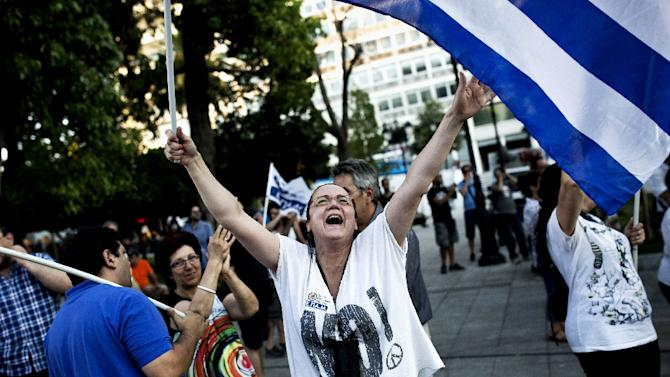 A woman celebrates the No vote victory at Syntagma Square in Athens on July 5, 2015