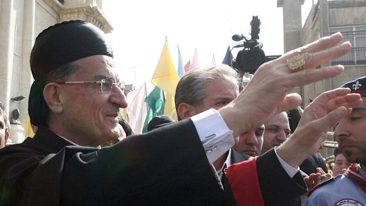 Maronite Patriarch Beshara Rai is greeted by supporters as he arrives to attend the enthronement of Syria's Greek Orthodox leader Yuhanna X Yazigi at the Holy Cross church in Damascus, on February 10, 2013