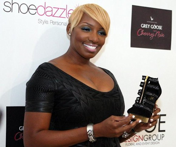 COMMERCIAL IMAGE - The Real Housewives of Atlanta stars NeNe Leakes at the Unveiling of Nethia, Saturday, Aug. 25, 2012 in Atlanta.  The Nethia is a shoe design by NeNe. (Photo by Wilford Harewood/Inv