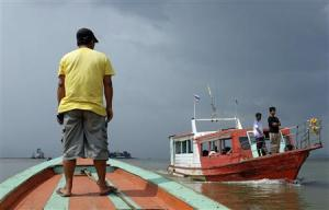 Men stand in boats crossing the invisible maritime …