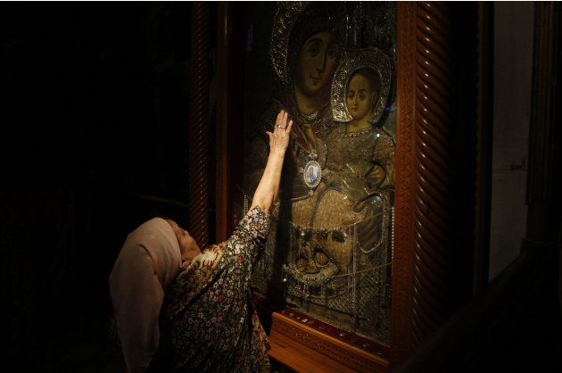 A file photo shows a Christian worshipper praying in the Church of the Nativity in Bethlehem