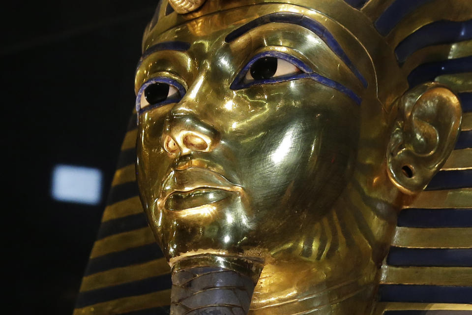 FILE - In this Saturday, Jan. 24, 2015, file photo, the gold mask of King Tutankhamun is seen in its glass case during a press tour, in the Egyptian...