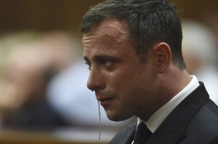 Oscar Pistorius reacts during judgment at the North Gauteng High Court in Pretoria. (REUTERS)