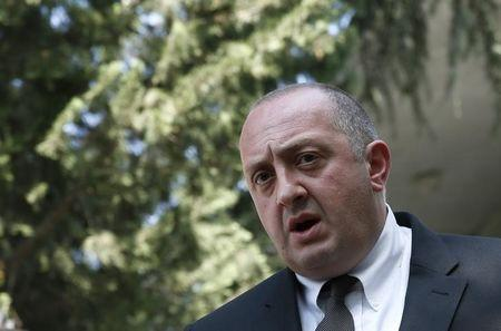 Georgia's President Margvelashvili speaks to the media after leaving the residence of the late Georgia's former president and Soviet foreign...
