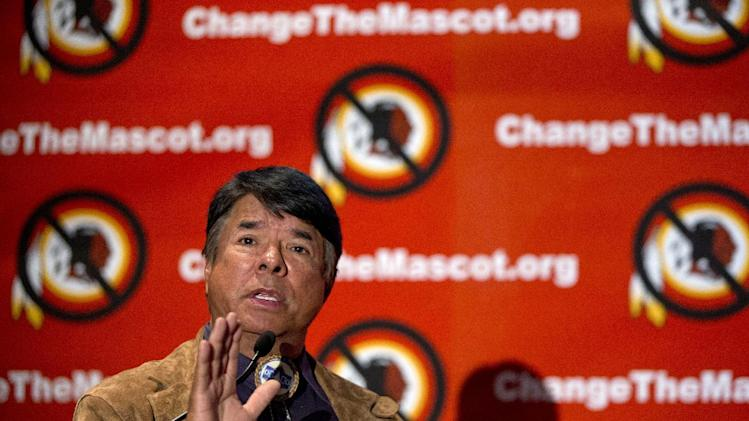 """Ray Halbritter, National Representative of the Oneida Indian Nation gestures as he speaks during the Oneida Indian Nation's Change the Mascot symposium, Monday, Oct. 7, 2013, in Washington, calling for the Washington Redskins NFL football team to change its name. During an interview, President Barack Obama suggested that the owner of the Washington Redskins football team consider changing its name because, the president said, the current name offends """"a sizable group of people."""" (AP Photo/Carolyn Kaster)"""