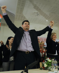 FILE - This file photo dated on June 7, 2009 shows Hungary's far right party, Jobbik's, Csanad Szegedi, left, and Krisztina Morvai, right, celebrating their entry into the European Parliament after the European parliamentary election in Budapest, Hungary. Szegedi, who was notorious for his incendiary comments on Jews, acknowledged in June that his grandparents on his mother's side were Jews. After resigning last month from all his party positions he was also asked by Jobbik to give up his seat in the European Parliament as well. (AP Photo/Bela Szandelszky, File)