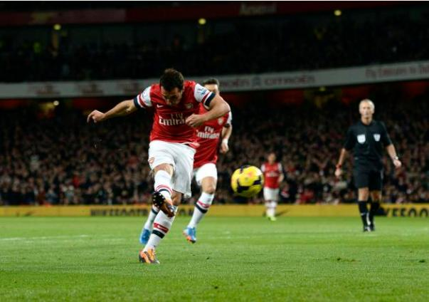 Arsenal's Cazorla scores a goal against Liverpool during their English Premier League soccer match at the Emirates stadium in London