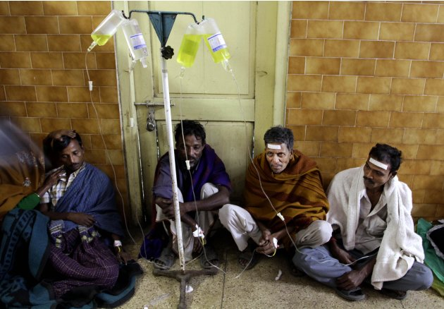 Indian patients take saline as they are treated after drinking toxic alcohol, in hospital in Diamond Harbour, near Kolkata, India, Thursday, Dec. 15, 2011. A tainted batch of bootleg liquor has killed