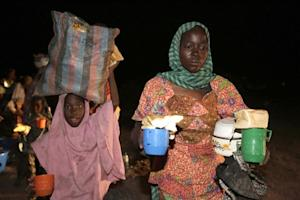 A woman and a child rescued by Nigerian soldiers from …