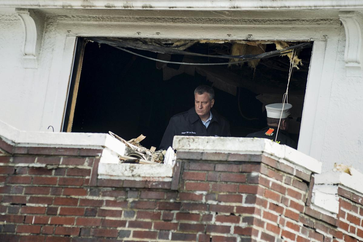 New York Mayor Bill de Blasio surveys the aftermath of home fire in the Midwood neighborhood of Brooklyn, New York