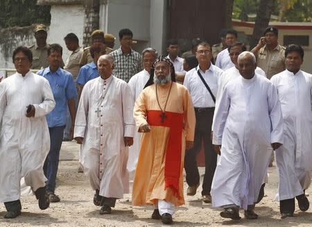 Indian Cardinal Baselios Cleemis Thottunkal walks out of the Convent of Jesus and Mary school after meeting with the school staff in Ranaghat