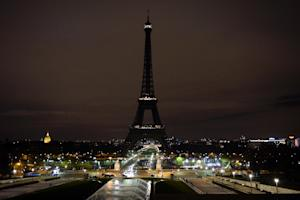 The Eiffel Tower turns its lights off as France mourns