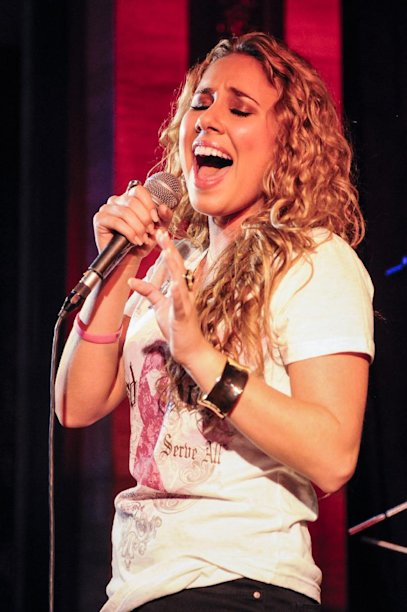 """IMAGE DISTRIBUTED FOR HARD ROCK - Haley Reinhart, who placed third in the tenth season of """"American Idol"""" performs at the Under 40 Music Marathon as part of Hard Rock's 12th Annual PINKTOBER breast cancer awareness campaign at Hard Rock Cafe, on Friday, Sept. 28, 2012, in Washington. (Invision for Hard Rock/AP Images)"""
