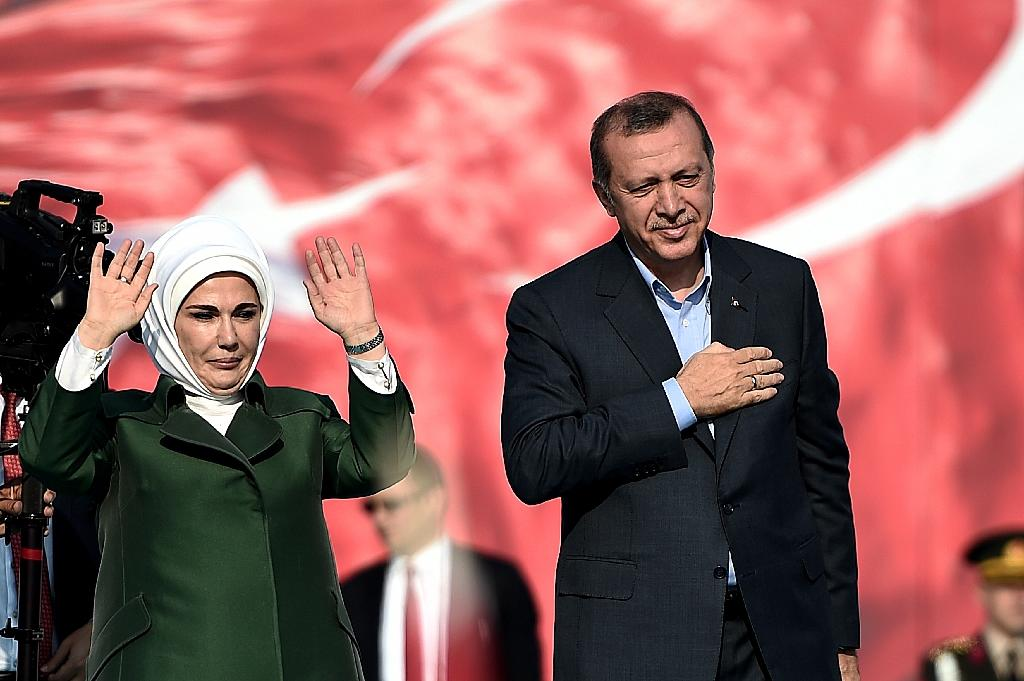 "Turkish President Recep Tayyip Erdogan (R) and his wife Emine Erdogan (L) greet supporters during an ""anti-terorrism"" rally in Istanbul on September 20, 2015"