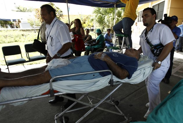 A patient is evacuated from Hospital Monsenor Sanabria following an earthquake in Puntarenas, north of San Jose, September 5, 2012. A 7.6 magnitude earthquake rocked Costa Rica on Wednesday, killing at least two people, sparking landslides, knocking down buildings, and briefly triggering a tsunami warning. REUTERS/Juan Carlos Ulate (COSTA RICA - Tags: DISASTER)