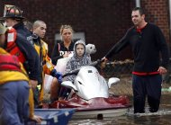 A resident assists rescue workers with his jet ski to rescue residents from flood waters brought on by Hurricane Sandy in Little Ferry, New Jersey October 30, 2012. REUTERS/Adam Hunger