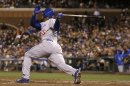 Los Angeles Dodgers' Yasiel Puig follows through on a solo home run off San Francisco Giants pitcher Matt Cain during the fifth inning of a baseball game in San Francisco, Tuesday, Sept. 24, 2013. (AP Photo/Jeff Chiu)