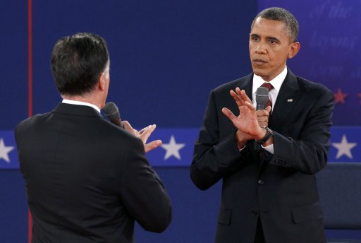 Republican presidential nominee Romney and U.S. President Obama speak directly to each other during the second U.S. presidential campaign debate in Hempstead