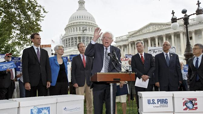 Sen. Bernie Sanders, I-Vt., center, joined by Congressional Democrats, and others, speaks at a news conference on Capitol Hill in Washington, Monday, Sept. 8, 2014, calling for an amendment to the Constitution aimed at curbing special interests' financial clout in elections. From left are, Robert Weissman, president of Public Citizen, Margery F. Baker, executive vice president for policy and program at People for the American Way, Sen. Tom Udall, D-N.M., Sanders, Sen. Sheldon Whitehouse, D-R.I., Rep. Ted Deutch, D-Fla., and Sen. Al Franken, D-Minn. Members of the Senate and the House of Representatives return to Capitol Hill today after a five-week vacation. (AP Photo/J. Scott Applewhite)