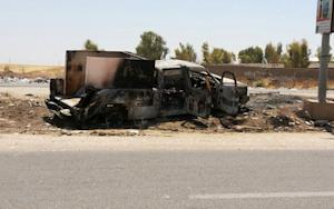 A burned police truck is left behind in the northern …