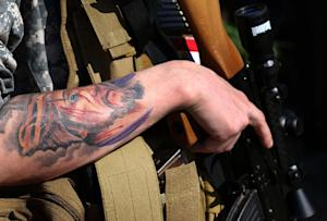 "Christian militia volunteer ""Brett"" has a …"
