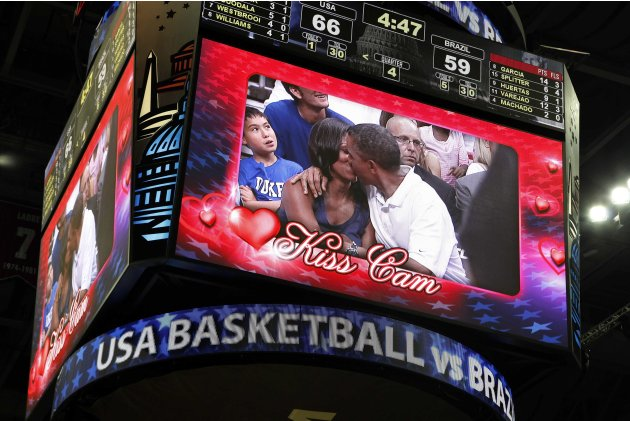 U.S. President Obama and first lady Michelle Obama are shown kissing on the