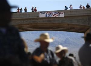 Protesters place a sign on a bridge near the Bureau…