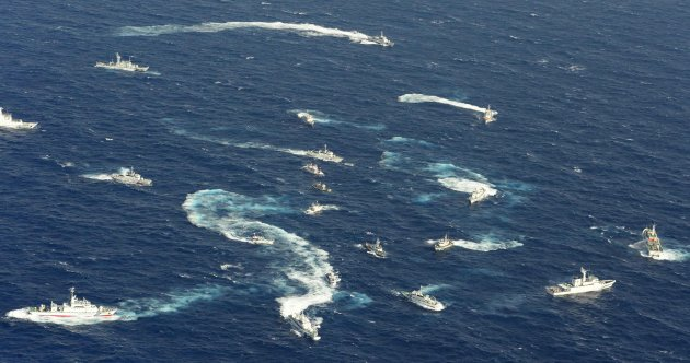 An aerial view shows Japan Coast Guard patrol ship, fishing boats from Taiwan and Taiwan's Coast Guard vessel sailing side by side near the disputed islands in the East China Sea, known as Senkaku in Japan, Diaoyu in China and Tiaoyutai in Taiwan, in this photo taken by Kyodo September 25, 2012.  A group of fishermen from Taiwan said as many as 100 boats escorted by 10 Taiwan Coast Guard vessels would arrive in the area later on Monday. Mandatory Credit. REUTERS/Kyodo (JAPAN - Tags: POLITICS) FOR EDITORIAL USE ONLY. NOT FOR SALE FOR MARKETING OR ADVERTISING CAMPAIGNS. THIS IMAGE HAS BEEN SUPPLIED BY A THIRD PARTY. IT IS DISTRIBUTED, EXACTLY AS RECEIVED BY REUTERS, AS A SERVICE TO CLIENTS. MANDATORY CREDIT. JAPAN OUT. NO COMMERCIAL OR EDITORIAL SALES IN JAPAN. YES
