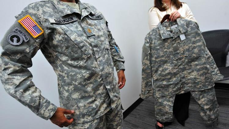 A prototype of a the new female specific Women's Army Combat Uniform is modeled on the left and the bulkier, stright cut standard issue unisex uniform is at right October 12, 2010