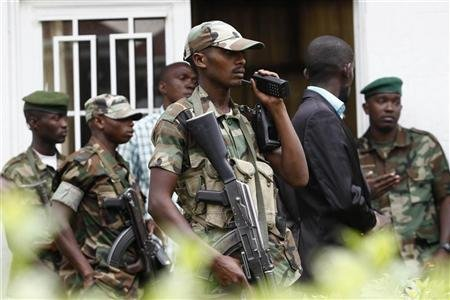 M23 rebel fighters guards the venue of press conference in Bunagana in eastern Democratic Republic of Congo January 3, 2013. REUTERS/James Akena