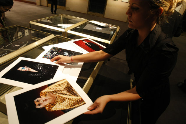 Auctioneers Pierre Berge Associes' employee Amelie Sieffert displays previously unpublished portraits of Michael Jackson at Drouot auction house  in Paris, Friday Oct. 15, 2010. The portraits were sho
