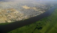 An aerial view of Malakal town in South Sudan, 497km (308 miles) northeast of capital Juba, is seen along River Nile, December 30, 2013. REUTERS/James Akena
