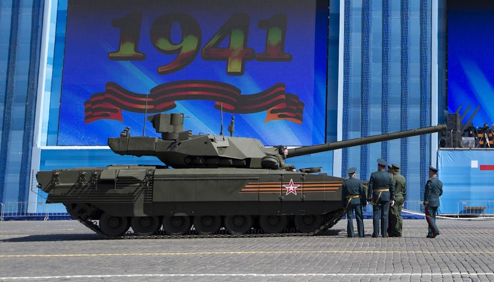 Russian army officers discuss a situation with a crew member of the new Russian T-14 Armata tank at the Red Square during a preparation for general...