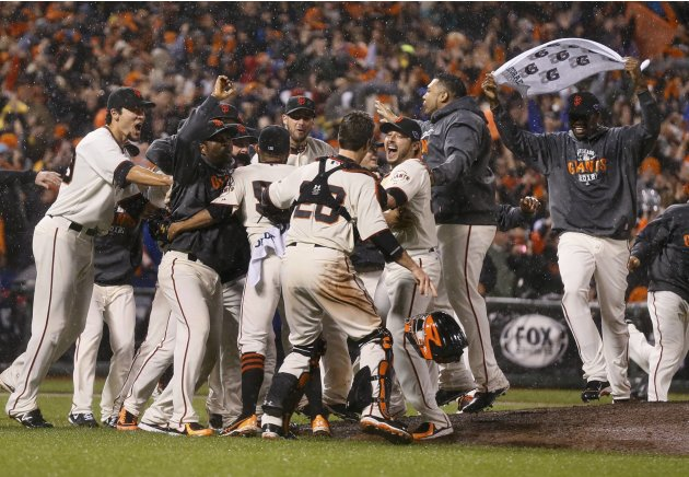 The Giants celebrate after defeating the Cardinals to advance to the World Series after Game 7 in their MLB NLCS playoff baseball series in San Francisco