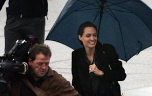 Hollywood superstar Angelina Jolie (R) is welcomed …