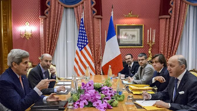 US Secretary of State John Kerry (L) and French Foreign Minister Laurent Fabius (R) chat before a meeting at the Beau Rivage Palace Hotel March 28, 2015 in Lausanne