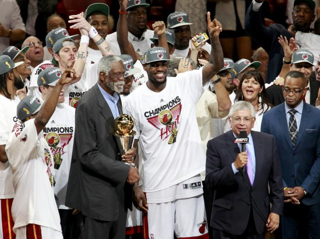 NBA great Russell prepares to present the NBA Finals MVP trophy to Miami Heat's James after Game 5 of the NBA basketball finals against the Oklahoma City Thunder in Miami