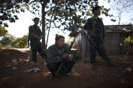 In this Jan. 31, 2013 photo, Kachin Independence Army soldiers guard an outpost on the Law Hpyu hilltop, one of the last hilltop outposts defending Laiza, where the guerrilla group's headquarters are located, in northern Myanmar's Kachin-controlled region. Kachin state is home to the last rebel insurgency left fighting in Myanmar that hasn't signed a cease-fire with President Thein Sein's government. Although the hills around Laiza have grown quiet for now, the dramatic upsurge in fighting underscored how far Myanmar is from achieving one of the things it needs most - a political settlement to end not just the war with the Kachin, but simmering conflicts with more than a dozen other rebel armies which have plagued the country for decades and still threaten its future. (AP Photo/Alexander F. Yuan)