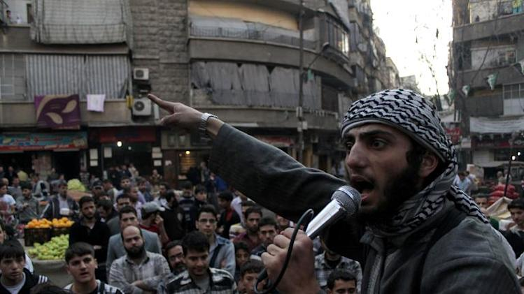 A member of the Islamic State of Iraq and the Levant (ISIL) speaks into a microphone urging people to join their fight against the regime, in Aleppo on November 13, 2013